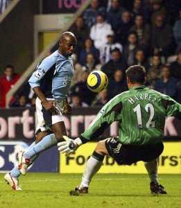 Luis Boa Morte chips Harper in the Newcastle goal