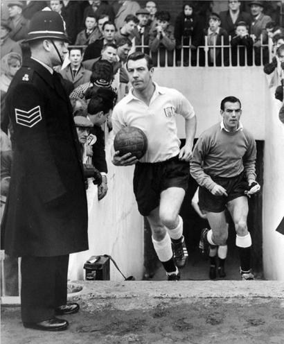 Johnny Haynes leads Fulham out
